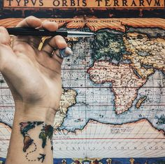 This tattoo represents goals of travel. A map sure looks cool tattooed on a wrist.