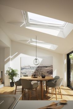 Love how the daylight streams through onto this open plan dining room extension. makes it so light and bright. Perfect way to add velux roof windows to a single storey extension Open Plan Kitchen Living Room, Kitchen Dining Living, Open Plan Living, Dining Area, Dining Rooms, House Extension Plans, House Extension Design, Extension Ideas, Layout Design