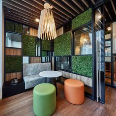 Bringing nature inside to create a soothing aura with green surroundings, for a inspiring, supportive workplace that exudes the company's team ethos to create a sense of belonging for staff Green Walls, Workplace, Spaces, Create, Nature, Table, Furniture, Home Decor, Naturaleza
