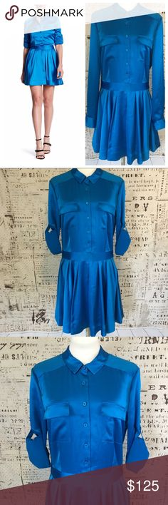 "New! DKNY Long Sleeve Satin Shirt Dress SZ 10 New! DKNY Long Sleeve Satin Shirt Dress SZ 10. Super chic!  Beautiful Cerulean Blue Collared Button Down Front with fitted waist and pleated skirt. Sleeves can be worn rolled up or long. Side zipper enclosure. 86% Triacetate 14% Polyester. Pit to Pit: 20"". Waist:  32"". Length:  35"". Original Retail:  $ 298. ***Exempt from Bundle Discount*** Dkny Dresses Midi"