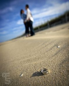 A staple 'engagment shoot on the beach' shot for me. I like this one.