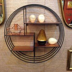 Circular black wire shelving unit with small copper shelves from Trouva boutique After Noah. Easily wall mountable and suitable for any room, these are great to add trend led pieces into your space without the commitment.