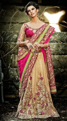 Trendy dark cream and pink faux georgette, net half and half saree which is decked with a floral patch and resham embroidery work on the first half, lace work in the horizontal panel, cut work on the lower part and zari embroidery work on the border. This outfit comes with a matching blouse piece. The blouse of this saree can be stitched in the maximum bust size of 42 inches. Product Code  3FD4544375