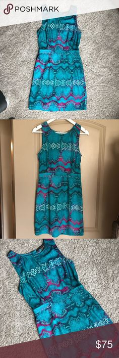 Silk snake print cocktail dress Gorgeous, unique, and flattering. Teal & purple snake print silk dress with concealed back zipper. Non sheer. By Charlie Jade. Excellent condition.  100% Silk. Dry clean.  Size Small. Fits size 4-6. Dresses Midi