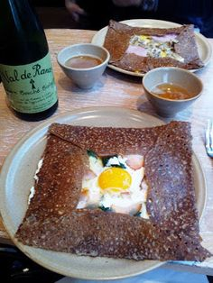 This is a typical salty/dinner crêpe, made with buckwheat flour. Lots of tradition shown here: the egg yolk in the center, sides folded so the crêpe is square, and fermented cidre to drink.