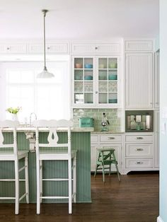 I simply adore the crisp white and the mix of greens in this kitchen.  Also love, love, love the bead board.