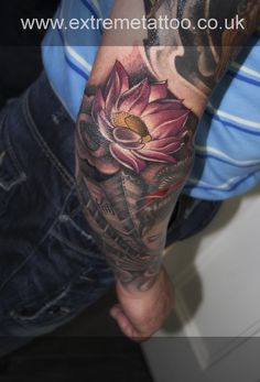 Pink lotus flower tattoo,sleeve in progress,Gabi Tomescu.Extreme tattoo&piercing. Fort William.Highland.Realistic tattoo, Black and grey tattoo, Japanese tattoo, Traditional tattoo, Floral tattoo, Chinese tattoo, Fine line art tattoo, Old school tattoo, Tribal Tattoo, Maori tattoo, Religious tattoo, Pin-up tattoo, Celtic tattoo, New school tattoo, Oriental tattoo, Biomechanical tattoo
