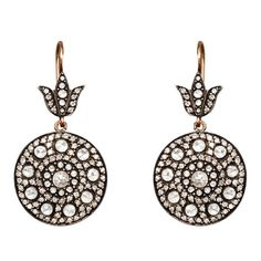 Rose Diamond Cluster Ear Pendants. In the style of Ancient Muscovy, each pave-set with a co-centric clusters of rose diamonds, suspended from a diamond set leaf-shaped motif, mounted in silver and 9k rose gold, the reverse engraved with repousse motifs.   With French control marks. 20th century