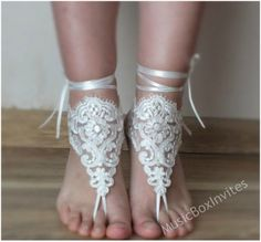 We don't like to walk in sand wearing heels! Try these pretty beach wedding sandals instead. They're total non-shoes!