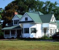 Farmhouse style metal roof by MRA member McElroy Metal