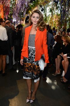 At Dior, Olivia Palermo debuted color and pattern in her boldly floral look of black, white, and orange.