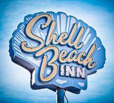 Shell Beach Inn by Shakes The Clown, via Flickr | retro vintage + sign neon + blue yellow white: