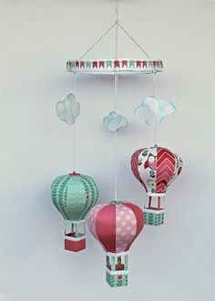 Baby mobile tutorial. Tutorial and template for paper hot air ballons. Created by Kirsten Hyde.