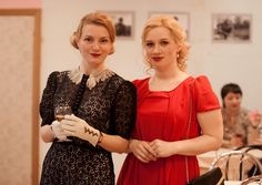 Ladies showing off their 1940s style in a retro party. 2015.