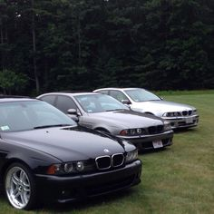 Three BMW e39's in a row. 2 540i's and an M5 in the middle.