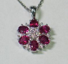 Ruby and diamond flower pendant, WTG Henderson, Jeweller, Perth, Scotland     See amazingly beautiful photos of ruby antique jewelry and more on my Jewelry Board @http://bit.ly/RJgSdp. Check out the latest Videos, News Tips & Trends in Ladies Fashion @ http://www.ladiesfashioninfo.com