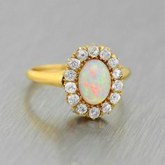 We're starting off our day with this beautiful and vibrant Victorian opal and mine cut diamond ring! The diamonds weigh approx .70ctw and the opal is iridescent and mesmerizing! Perfect piece for any opal lover. Available now at abrandtandson.com