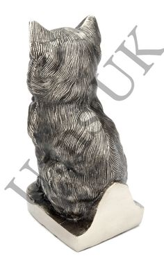 """This 'Sitting Sweet' Cat Cremation Urn.  Engraving is possible on the back of the base.  You pet's ashes can be safely placed in the urn via a secure bottom opening. Material: Solid Aluminium Finish: Antique Silver Size: 7.5""""  high  Capacity: 35 cubic inches - suitable for cremains of pet body weight approx 35lbs or 15kg"""
