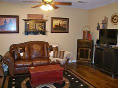 Mix of western decor and antiques for the living room.