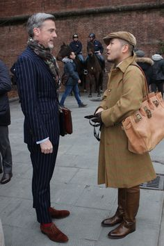 A Dunhill customer of old, in raincoat, boots and cap. Men's Fall Winter Street Style Fashion.