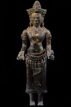 GILD FIGURE OF A FEMALE DEITY A Bronze Gild figure of a female deity Angkor Wat 12th Century 21.5cm Provenance: Ex Douglas Latchford collection