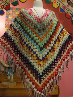 70s BOHO KNIT CROCHET GRANNY SQUARE FRINGE PONCHO. I didn't like them then, and don't like them now. That comes from someone in the family always trying to force their crochet or knitting items on you. Not just giving them to you....trying to make you wear them also.