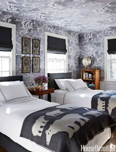 """We started with Fornasetti's Nuvolette wallpaper in a son's room, and that took us in this moody direction,"" Gorrivan says. Matouk linens on Savoir beds. Maura McEvoy  - HouseBeautiful.com"