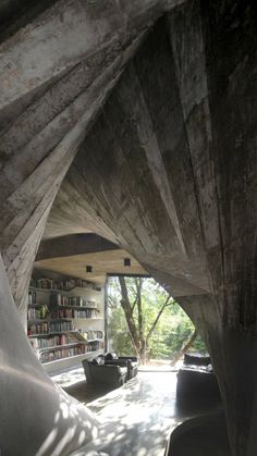 Ah, that concrete, wall-to-wall bookshelves, access to trees to climb, comfortable sofas with natural reading light.