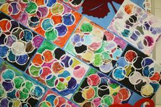 Found this painting project on Pinterest, from this blog: http://innerchildfun.com/2009/08/modern-art.html  Wanted to try it with my 1st graders and tried the circle printing with rubber cement instead of paint. I printed the circles and the students painted. We rubbed off the cement after everything was dry. They turned out awesome!!!
