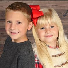 Sibling photo idea: Red and rustic accents.   Share the love this Valentine's Day with a sweet and simple family photo. Recreate this look with red accessories and the new Wood Background available at JCPenney Portraits.
