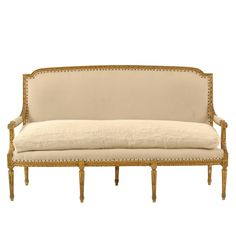 Found Vintage Rentals Giselle Cream Couch was custom upholstered in a cream linen, and topped off with a custom made European grain sack cushion.