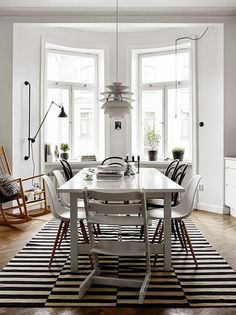 Beautiful black and white dining rooom. Perfect for pre-war apartment or bungalow. Kilim rug - try places like World Market or IKEA. via Pella Hedeby #home #decor #rug #dining #dining_table #midcentury #modern #lighting #normanncopenhagen #Scandi