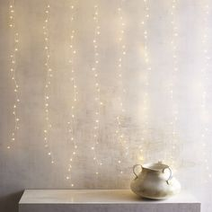 For a fabulous, intimate lighting accent, think small. Our electric Glimmer Strings® use tiny white LEDs on a curtain of shapable, thread-sized silver filament strings to create a firefly-like effect indoors and in covered outdoor areas. Compatible LED Candle Remote (sold separately) allows them to be turned on or off at a touch. Built-in timer provides automatic shutoff.