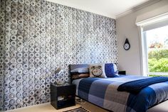 Designer: OMNI Interiors, Australia A textured look with a metallic finish, this wall mural of washers is on a grey textured background, making a great addition to this contemporary bedroom.