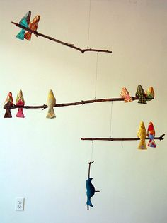 Bird Mobile: Fabric birds, monofilament and branches make this lovely mobile.