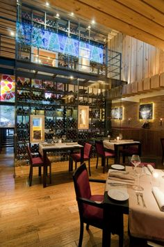 Located in Santiago, Chile, La Boquería de Barcelona is a restaurant with a Catalan cuisine. The building in which the restaurant has been designed was previously a steak house with two levels.