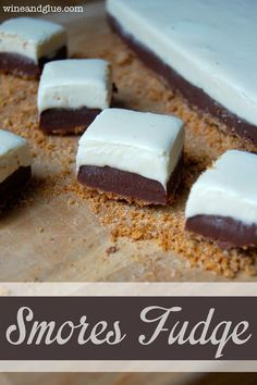 S'mores Fudge with a graham cracker crust and  delicious marshmallow fudge topping sandwiching delicious chocolate fudge! via www.wineandglu...
