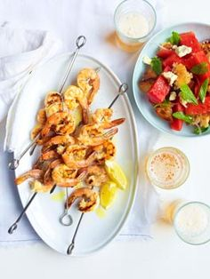 Char-grilled prawns with watermelon, feta and torn bread