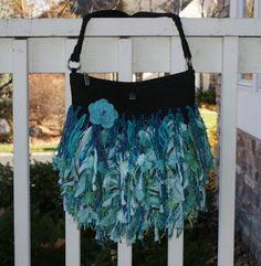 Love this idea!  Upcycled purse, embellished with yarn and fabric.
