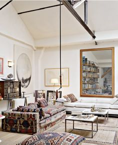 French designer Pierre Yovanovitch used kilim remnantsto add texture and drama to a simple interior