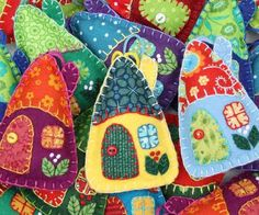 Set of three little hanging houses, handmade with felt and vintage cottons in bright colors. The roofs, doors and windows are hand- appliqued with vintage cotton fabrics, embroidered berries grow on t