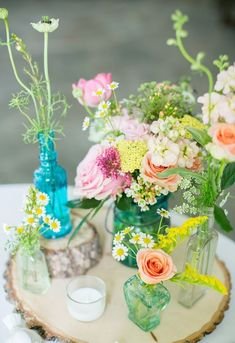 This is exactly what I have been envisioning in my head. Smaller jars of diff colors with diff kinds of flowers.