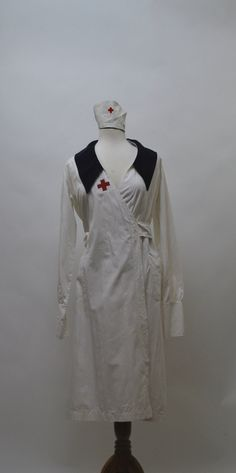 1930S NURSES UNFORM    - SIZE 38  - FRENCH CUFFS  - ORIGINAL MATCHING HAT  - RANK PATCH STRIPE ON LEFT ARM  - RED CROSS BADGE ON BREAST   WHITE BELT