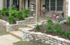 Stack Stone Border.  A little more color and texture in the beds and this would be spectacular.  Way to lay some stones!