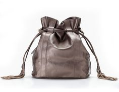 """La Poet Women's Genuine Leather Drawstring Shoulder Bag (Silver). Soft and slouchy, perfect size for I-pad, umbrella, a bottle of water and daily essentials. Made of premium top pebble leather with soft hand feel and beautiful shine. Magnetic snap top closure with tasseled drawstring giving a vintage and stylish look. Dimensions: 13L x 12H x 6.5W inch. Adjustable shoulder strap with 20"""" drop. Cotton lining, interior with 1 x wall zipper, 2 x multi-function pockets."""