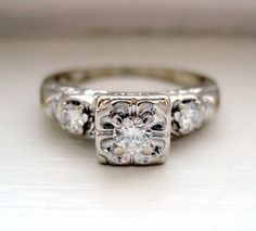 Looks like the ring I wear from my grandma.  Vintage Art Nouveau  Round Brilliant Diamond Ring 14kt by baffy21, $389.00