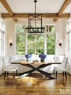Country White Breakfast Area with Bronze Pendants