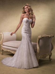 Wedding dress fit and flare so pretty!!