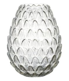 Clear glass. Large vase in textured glass. Diameter at top 3 1/4 in., height 9 in.