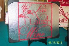 A Simply Said vinyl design in mirror image can be placed on the back of a tempered glass cutting board to make a beautiful, functional gift for the kitchen.  www.mysimplysaiddesigns.com/gail/$19.95